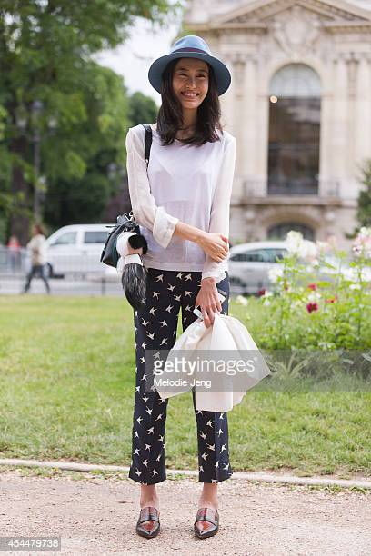 Model Shu Pei Qin after Chanel in a Maison Michel hat Dries Van Noten top Nina Ricci pants and a Fendi purseon Day 3 of Paris Haute Couture Fashion...