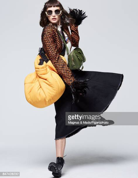 Model Sibui poses at a fashion shoot for Madame Figaro on July 8 2017 in Paris France Dress and jacket sunglasses tote Boston bag boots PUBLISHED...