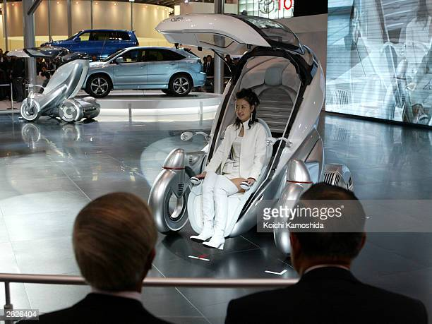 A model sits in a cockpit of Toyota's new concept car the 'PM' during the 37th Tokyo Motor Show at Makuhari Messe east of Tokyo October 22 2003 in...