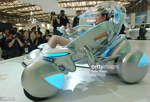 Model sits in a new Toyota I-unit concept car at the Auto Shanghai 2005 Exhibition on April 21, 2005 in Shanghai, China. Top world automakers are...