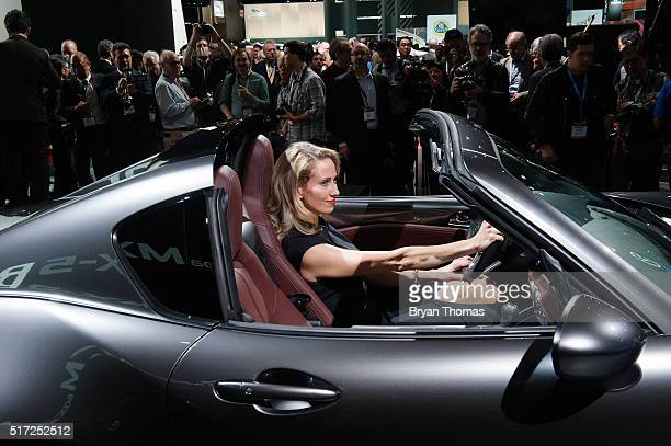 A model sits in the driver seat of the Mazda MX5 RF following its introduction at the New York International Auto Show at the Javits Center on March...