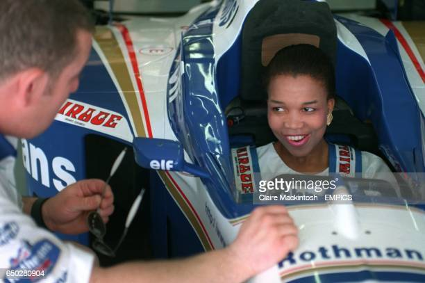 A model sits in the Williams Formula One at the Kyalami circuit
