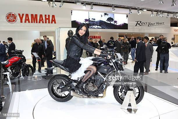 A model sits on a Yamaha motorbike during the 71st International Motorcycle Exhibition EICMA 2013 on November 5 2013 in Milan Italy