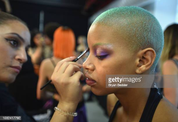 Model Slick Woods poses backstage for the Savage X Fenty Fall/Winter 2018 fashion show during NYFW at the Brooklyn Navy Yard on September 12 2018 in...