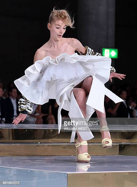 A model slips on the runway while parading an outfit by Australian designer Toni Maticevski at Fashion Week Australia in Sydney on May 15 2016 / AFP...