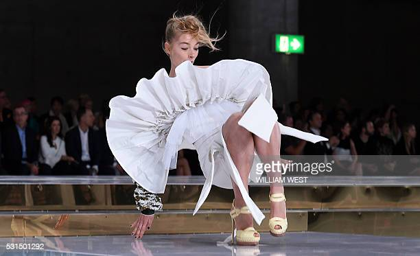 Model slips on the runway while parading an outfit by Australian designer Toni Maticevski at Fashion Week Australia in Sydney on May 15, 2016. / AFP...