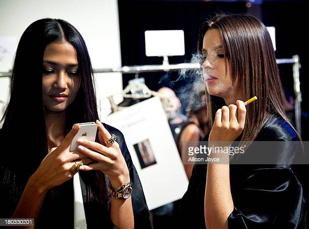 A model smokes an E cigarette backstage at the Meskita fashion show during MercedesBenz Fashion Week Spring 2014 at Center 548 on September 11 2013...