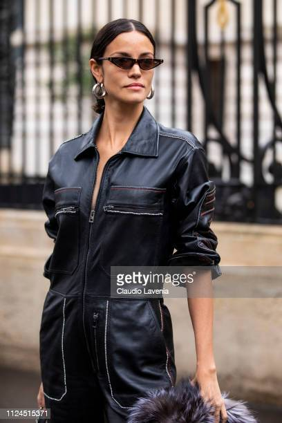 Model Sofia Resing wearing a black jumpsuit black boots and grey fur jacket is seen outside Zuhair Murad show during Paris Fashion Week Haute Couture...