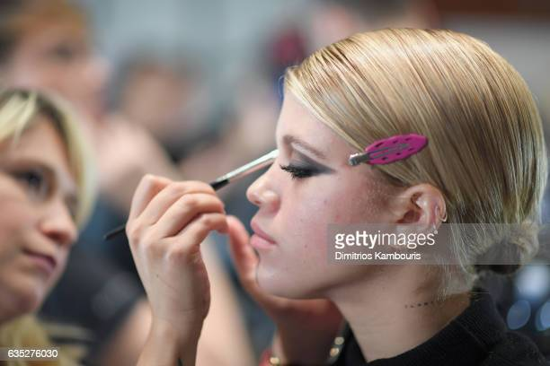 Model Sofia Ritchie prepares backstage for the Philipp Plein Fall/Winter 2017/2018 Women's And Men's Fashion Show at The New York Public Library on...