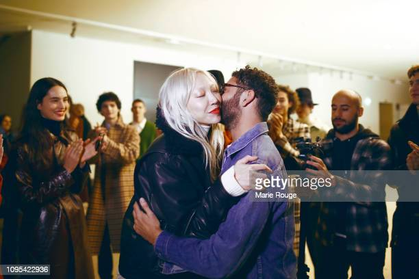 Model Soo Joo Park congratulates designer Alexandre Mattiussi backstage after the Ami Alexandre Mattiussi Menswear Fall/Winter 20192020 show at...
