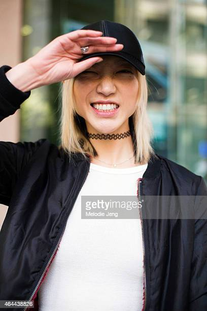 Model Soo Joo Park exits the Fay show in an Acne hat and Aritzia top on February 25 2015 in Milan Italy