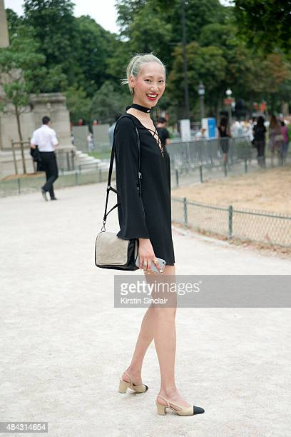 Model Soo Joo Park wears a Vintage dress and Chanel shoes on day 3 of Paris Fashion Week Haute Couture Autumn/Winter 2015 on July 7 2015 in Paris...