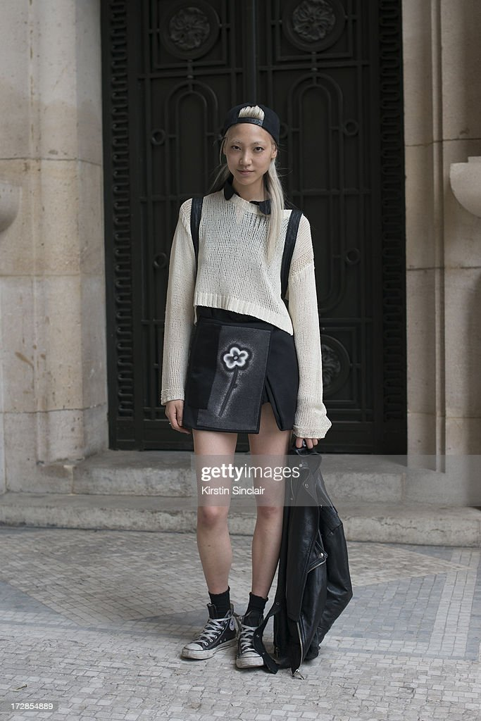 Model Soo Joo Park wears Opening Ceremony top, Prada skirt, Converse trainers and a Chanel bag on day 2 of Paris Collections: Womens Haute Couture on July 02, 2013 in Paris, France.