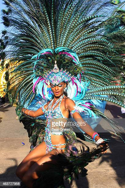 Model Soowan Bramble from the band 'Dominion of the Sun' by Harts performs in the Queen's Park Savannah during the Parade of Bands as part of...