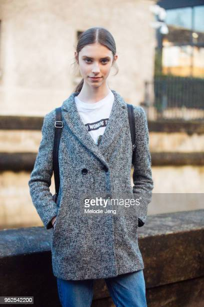 Model Sophie Martynova wears a gray coat after the Valentino show on March 04 2018 in Paris France