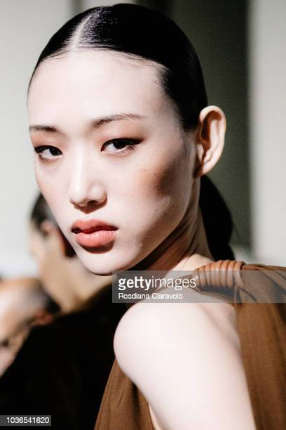 Model Sora Choi is seen backstage ahead of the Max Mara show during Milan Fashion Week Spring/Summer 2019 on September 20, 2018 in Milan, Italy.