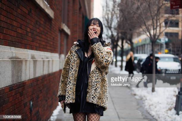 Model Sora Choi laughs and wears a leopard fur coat on Day 3 of New York Fashion Week Fall/Winter 2017 on February 11 2017 in New York City