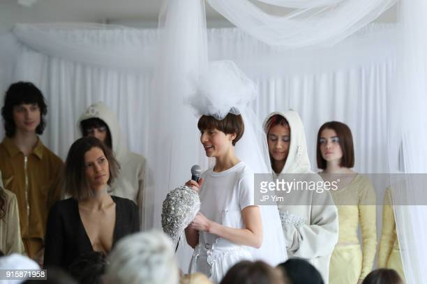 A model speaks at the Collina Strada AW18 Collection during New York Fashion Week on February 8 2018 in New York City