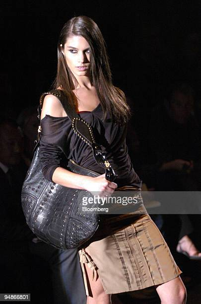 A model sports a provocative glance as she walks the runway at the Spring/Summer 2005 Gucci show in Milan Italy September 30 2004 It is the first...