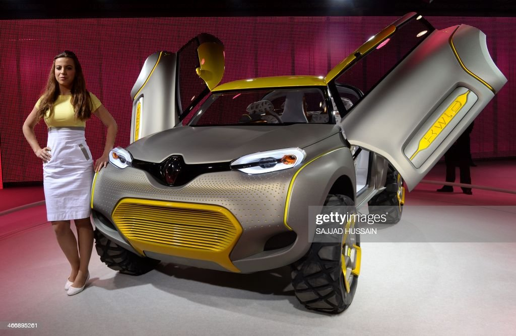 Car Expo Standsay : A model stands alongside the renault concept kwld motor car at the