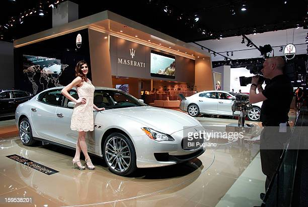 A model stands at the Maserati exhibit at the 2013 North American International Auto Show media preview at the Cobo Center January 15 2013 in Detroit...