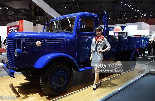 A model stands beside a 1948 Isuzu TX80 model 5ton truck at the Tokyo Motor Show in Tokyo on October 29 2015 The biennial motor show's 44th edition...