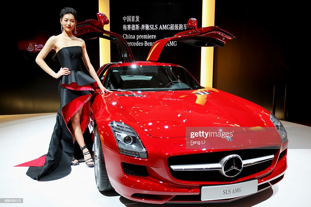 A model stands beside the China premiere display of Mercedes-Benz SLS AMG car during a special media opening of the Beijing Auto Show on April 24, 2010 in Beijing of China. Major global automakers plan to unveil dozens of new models at the Beijing auto show, which has quickly become one of the biggest and most important auto shows in the world and raises its curtains on Friday and will last till May 2, during which 990 models - with 89 making their global debut - will be displayed in a 200,000-sq-m area.
