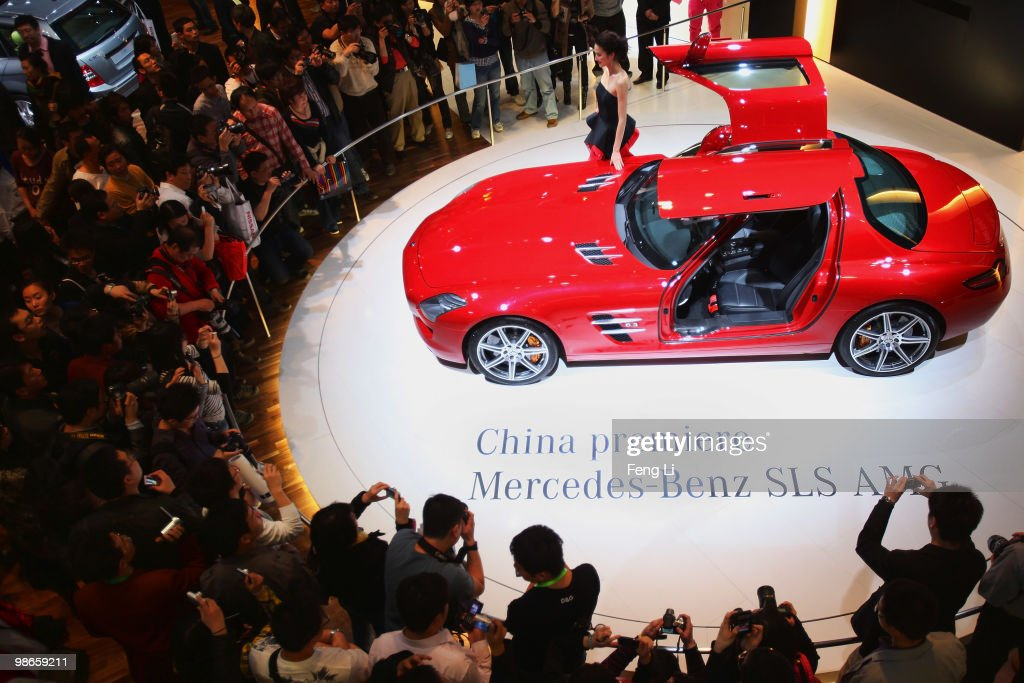 A model stands beside the China premiere display of Mercedes-Benz SLS AMG car during the Beijing Auto Show on April 25, 2010 in Beijing of China. Major global automakers plan to unveil dozens of new models at the Beijing auto show, which has quickly become one of the biggest and most important auto shows in the world and raises its curtains on Friday and will last till May 2, during which 990 models - with 89 making their global debut - will be displayed in a 200,000-sq-m area.