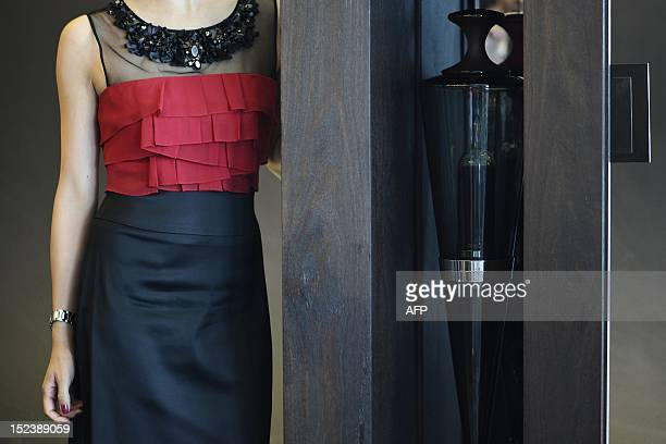 A model stands next to a Penfolds Limited Edition Ampoule Number 6 containing 2004 Kalimna Block 42 Cabernet Sauvignon in Hong Kong on September 20...