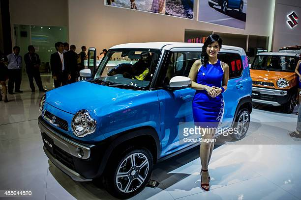 A model stands next to the Hustler by suzuki display at The 22st Indonesia International Motor Show 2014 on September 18 2014 in Jakarta Indonesia...