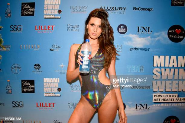 Model stays hydrated backstage with TEN Alkaline Water at Miami Swim Week Powered By Art Hearts Fashion Swim/Resort 2019/20 at Faena Forum on July...
