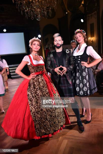 Model Stefanie Gaul designer Harald Gloeoeckler and a model during 'POMPOEOES By Angermaier Collection Presentation' at Deutsches Theatre on August...