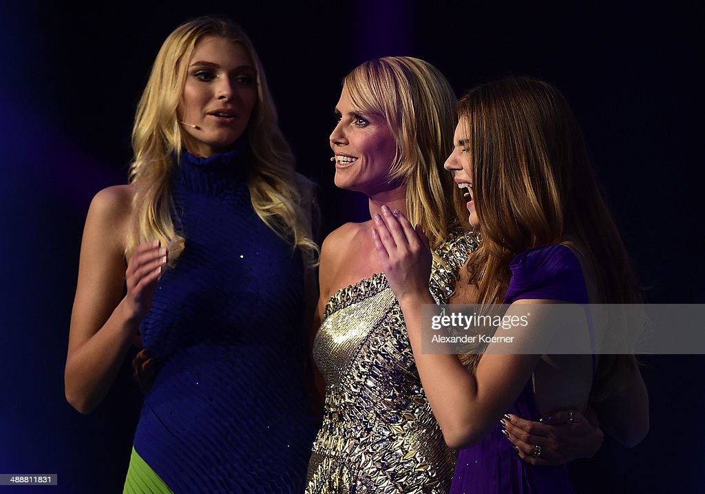 Model Stefanie Giesinger reacts next to model Heidi Klum (m) and second place Jolina Fust during the final of Germany's Next Top Model TV show at Lanxess Arena on May 8, 2014 in Cologne, Germany. Stefanie Giesinger was voted as winner of the 2014 Germany's Next Top Model TV show.