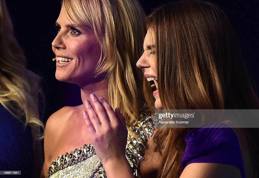 Model Stefanie Giesinger reacts next to model Heidi Klum during the final of Germany's Next Top Model TV show at Lanxess Arena on May 8, 2014 in Cologne, Germany. Stefanie Giesinger was voted as winner of the 2014 Germany's Next Top Model TV show.