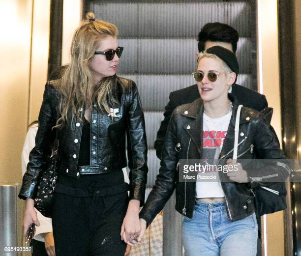 Model Stella Maxwell and actress Kristen Stewart are spotted at CharlesdeGaulle airport on June 13 2017 in Paris France