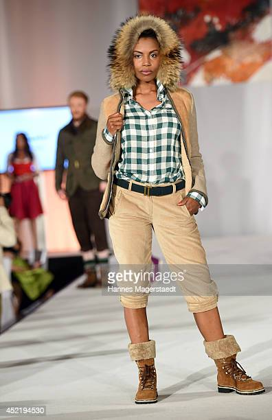 Model Stephanie Simbeck walks the runway during the Sixt ladies dirndl dinner on July 15 2014 in Munich Germany