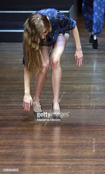 A model stumbles on the catwalk while showcasing designs by Life With Bird at the Designer Series Show 2 on the second day of Melbourne Spring...