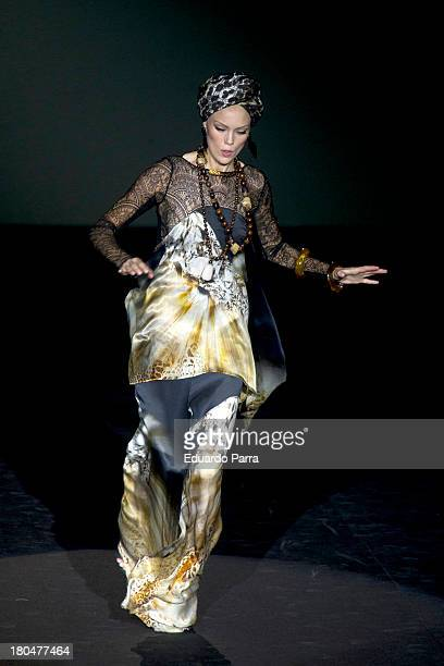 A model stumbles on the runway at Roberto Verino show during Mercedes Benz Fashion Week Madrid Spring/Summer 2014 at Ifema on September 13 2013 in...