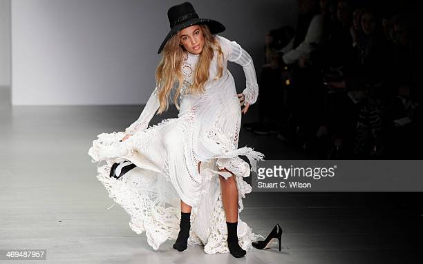 A model stumbles on the runway at the SIBLING show at London Fashion Week AW14 at Somerset House on February 15 2014 in London England