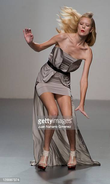 A model stumbles walking the runway in the Amaya Arzuaga fashion show during the Cibeles Madrid Fashion Week Spring/Summer 2012at Ifema on September...