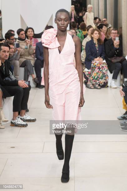 Model Subah Koj walks the runway during the Miu Miu show as part of the Paris Fashion Week Womenswear Spring/Summer 2019 on October 2 2018 in Paris...
