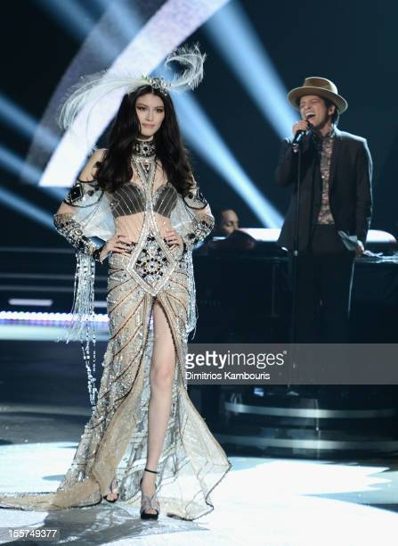 Model Sui He and musician Bruno Mars onstage during the 2012 Victoria's Secret Fashion Show at the Lexington Avenue Armory on November 7, 2012 in New...