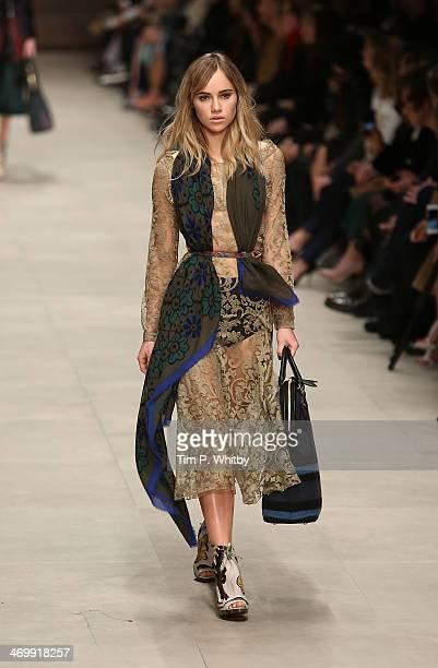 Model Suki Waterhouse walks the runway at the Burberry Prorsum show at London Fashion Week AW14 at Perks Fields Kensington Gardens on February 17...