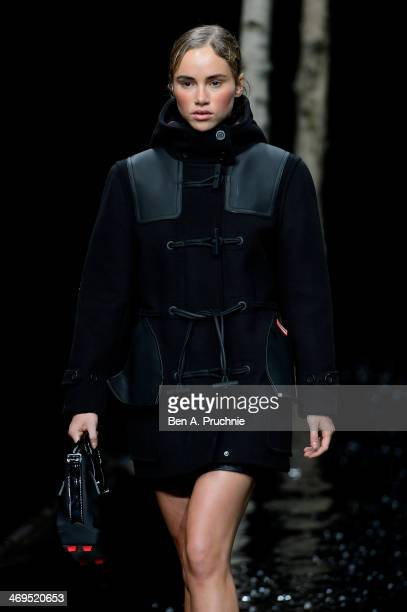 Model Suki Waterhouse walks the runway at the Hunter Original show at London Fashion Week AW14 at University of Westminster on February 15 2014 in...
