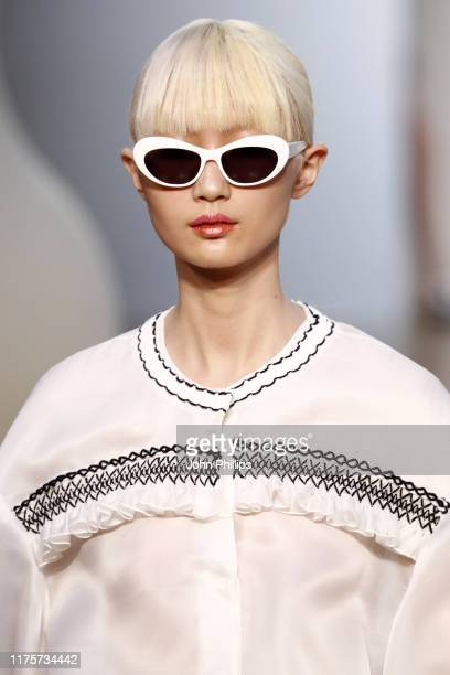 Model, sunglasses detail, walks the runway at the Vivetta show during the Milan Fashion Week Spring/Summer 2020 on September 19, 2019 in Milan, Italy.