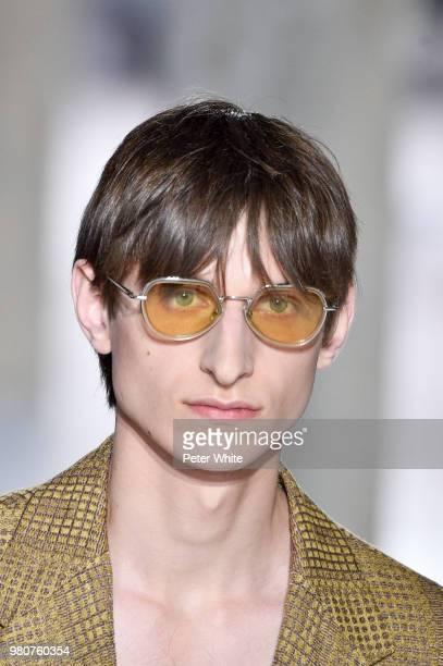 A model sunglasses detail walks the runway during the Dries Van Noten Menswear Spring/Summer 2019 show as part of Paris Fashion Week on June 21 2018...