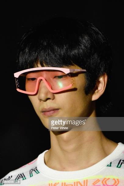 A model sunglasses detail walks the runway during the Kenzo Menswear Spring/Summer 2019 show as part of Paris Fashion Week on June 24 2018 in Paris...