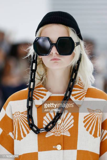 A model sunglasses details walks the runway at the Gucci Spring/Summer 2020 fashion show during Milan Fashion Week on September 22 2019 in Milan Italy