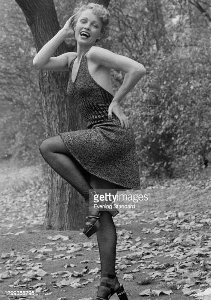 Model Suze wearing a halterneck dress with stockings and high heels, UK, 1st November 1972.