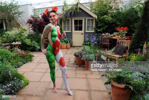 Model Suzi Taylor's body is painted symbolising the twin themes of sustainability and adaptability in the Real life by Brett Garden at the Chelsea...